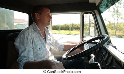 Speeding Truck - Lorry driver at the wheel of truck