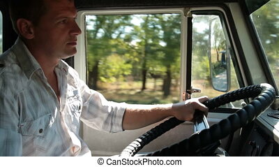 Truck Driver at the Wheel - Truck Driver Delivering Freight