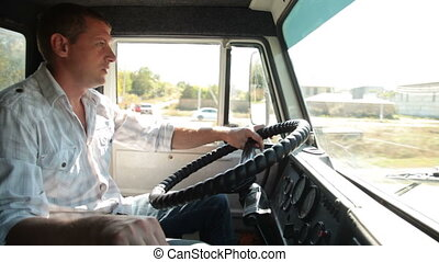 Driving Delivery Truck - Driver at the wheel of delivery...