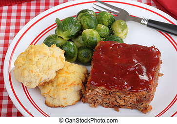 Meatloaf, Biscuits and Brussels Sprouts - Top view of a meal...