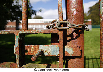 Locked school gate - Rusty school gate chained and locked