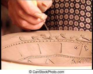 CERAMICS plate decoration 1 - Woman decorating a ceramic...