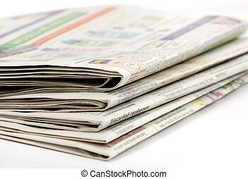 Newspapers stacked on a white background