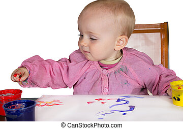 Cute baby experimanting with paint