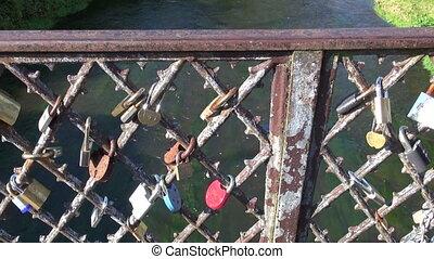 lovers locks on historical bridge