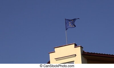 European Union flag on sky background and wind