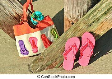 Flip flops and a beach bag - flip flops and a beach bag...