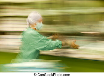 Blurred nurse runing busy working - Abstract, blurred figure...
