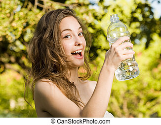 Hey, hydrate - Very cheerful beautiful young brunette woman...