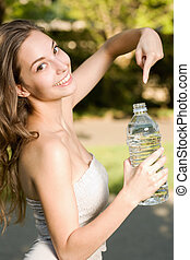 Hey, hydrate! - Very cheerful beautiful young brunette woman...