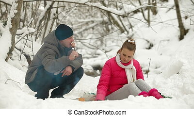 Teenagers Sitting by Bonfire
