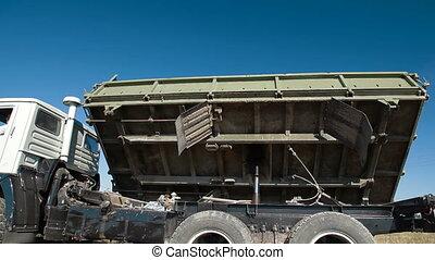 Truck Side Dumping - Dump Truck Dumping Freight