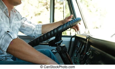 Lorry Driver at the Wheel of Truck, Closeup