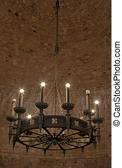 Medieval chandelier against brick background