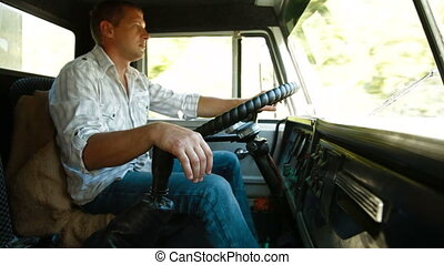 Driving Truck - Tired lorry driver at the wheel of truck