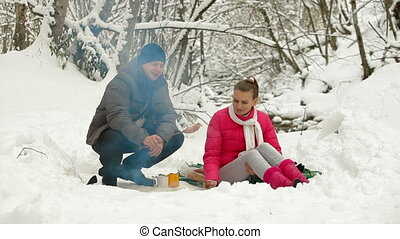 Teenage Couple  By Bonfire in Snow