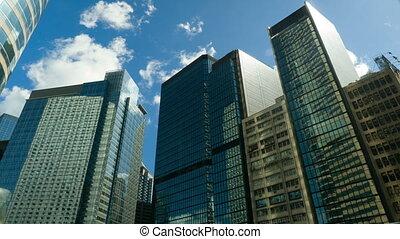 Skyscrapers over blue sky, timelapse