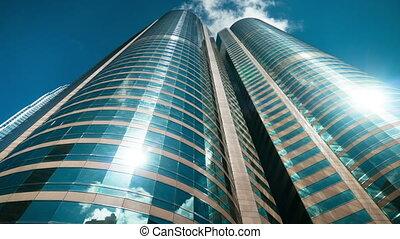 Skyscrapers over blue sky, timelapse, HD loop