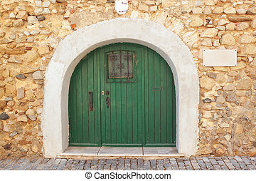 Old door arch gate in the old city of Faro. Portugal.