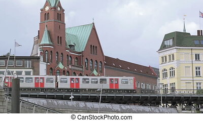 Metro train in Hamburg is passing by.