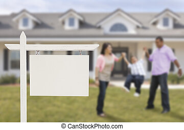 Blank Real Estate Sign and Hispanic Family in Front of House...