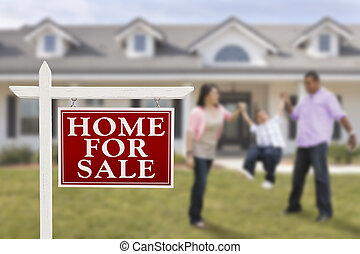 Real Estate Sign and Hispanic Family in Front of House -...