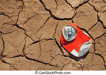 Empty soda can on dry soil - Thrown empty soda can on very...