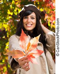 Autumn leafand woman