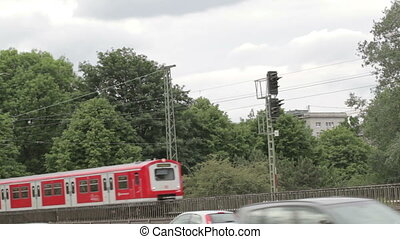 Red train in Hamburg. - Red train on the bridge passes by in...