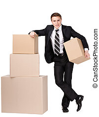 Manager stands near pile of cardboard boxes - Manager in...