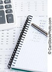 Close up of business writing pad, pen, calculator - Close up...