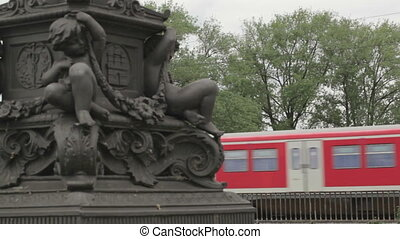 Red train in Hamburg - Red train on the bridge passes by in...