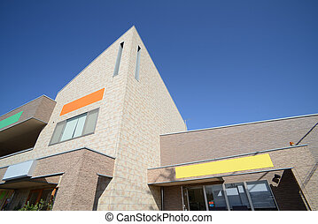Store front with blue sky