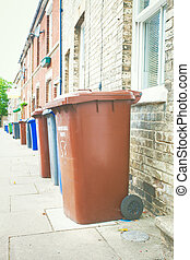 Rubbish bins - Row of plastic bins for collection in England