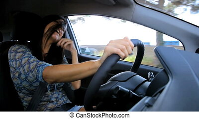 Woman singing loud driving car - Beautiful woman singing...