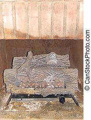 Rustic Fireplace Logs - Fireplace logs sit in a rustic...