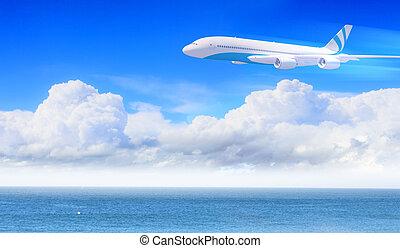 White passenger plane in the blue sky - White passenger...