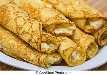 Blintzes (cheese pancakes) - Pancakes with cheese in white...