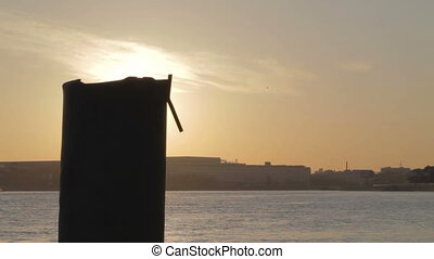 Sunrise in Saint Petersburg with big dark pipe. Sun...