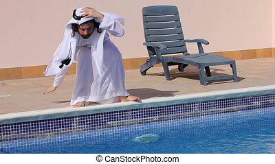 Saudi arabian at swimming pool