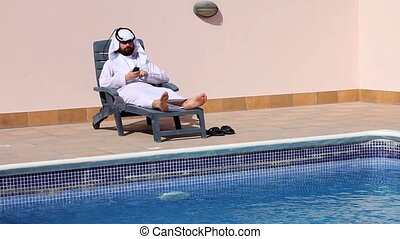 arabian talking phone at pool