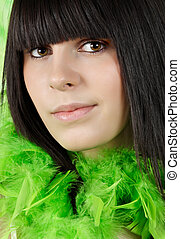 teen girl with green feather boa - closeup portrait of a...