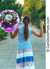 girl with flowers in the road