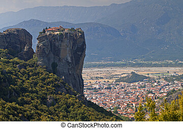 Monastery of saint Trinity at Meteora of Kalambaka in Greece and view of the city below the rocks