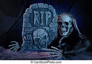 Skull monster and tombstone halloween decoration