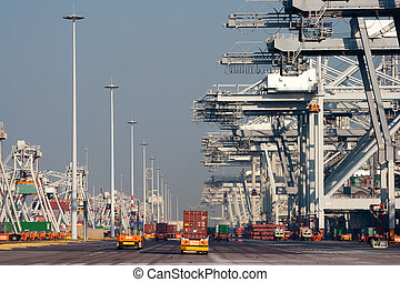 Container port - Harbor cranes and robot trucks with...