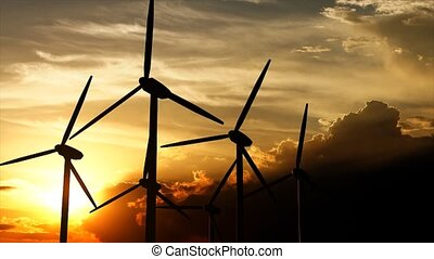 Wind turbine silhouette sunset