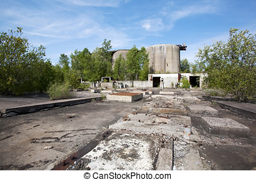 Long Abandoned Industrial Site - Long ago abandoned concrete...