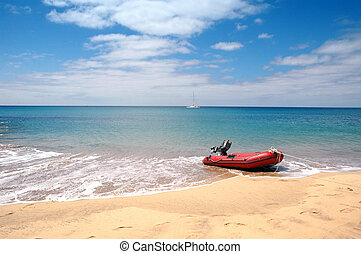 A dingy on the ocean in a tropical paradise.