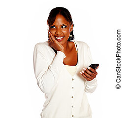 Excited young woman holding a black cellphone